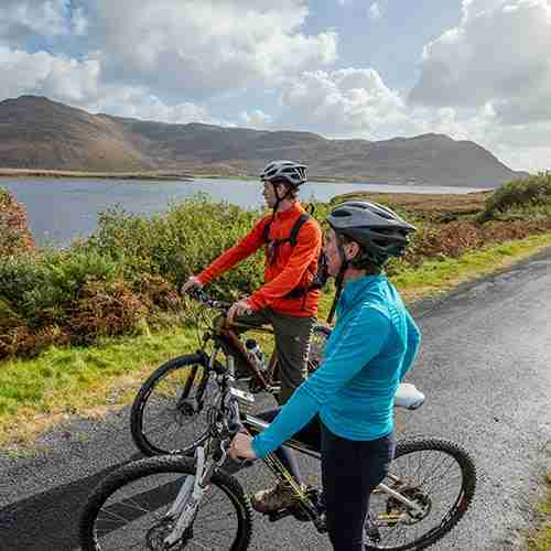 A couple wearing brightly coloured clothes on Waterford Greenway