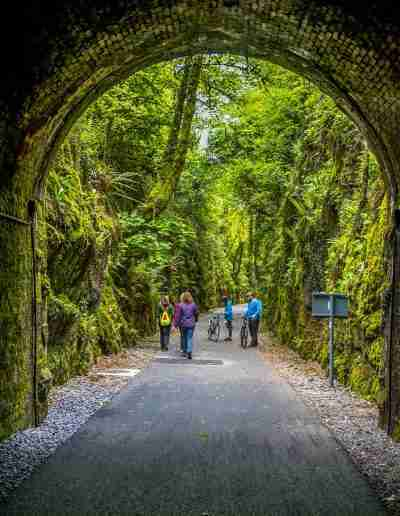 people ermerging from Ballyvoyle Tunnel, Waterford Greenway