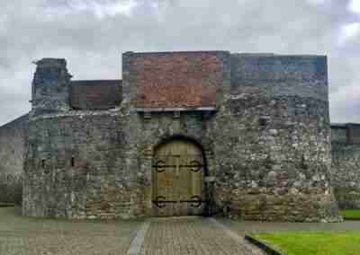 Front of Dungarvan Castle with double wooden entrance doors.